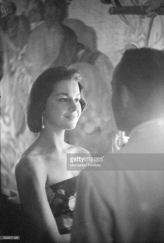 Countess Consuelo Crespi attending to a party during the XVIII Venice International Film Festival. Venice, 1957