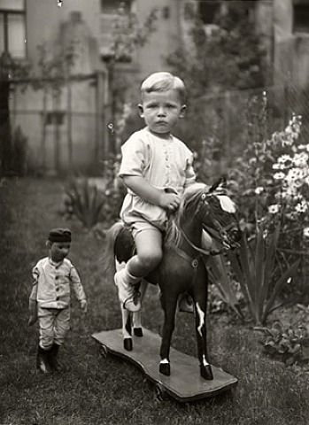 Little boy on his toy horse: