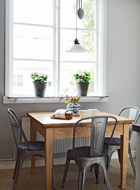 Square Wooden Dining Table // Metal Cafe Chairs // Indoor Plants // Large Windows // Home Decor