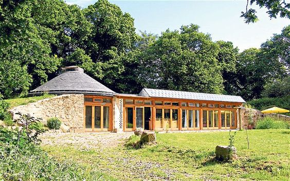 Money-maker: the 'earthship generates enough solar electricity that it actually earns Daren Howarth and his partner money