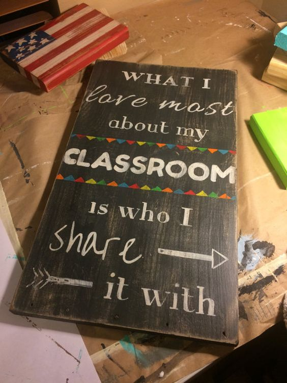 """Teacher Sign. What I love most about my classroom is who I share it with. Rustic wood sign. Teacher gift. Measures 12""""x19""""x3/4"""" thick"""