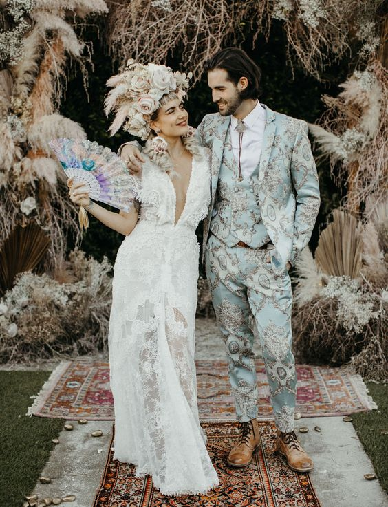 Have you ever seen a more stylish couple in love? Congrats #GLBride Nikia aka Mad Maven Style and her husband. Nikia wore two Galia Lahav gowns - this one is the beautiful #GALA1003 made from French lace, this sheath dress has a deep plunging v-neckline, an open back, capelet ruffle sleeves and a sheer feature in the front.