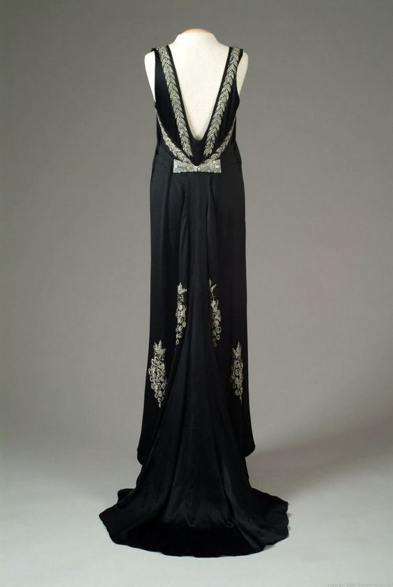 1935 Striped black satin crepe evening gown accented with rhinestone beaded grape clusters and rhinestone leaf edging around the neckline. Gown has a full train.