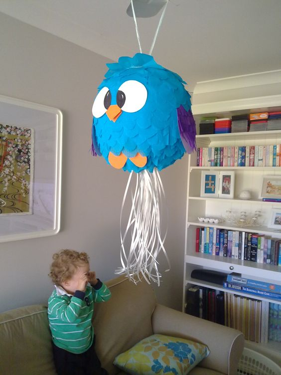 Owl Pinata made from a paper lantern and crepe paper that I already had around the house. Total cost: $5.00!