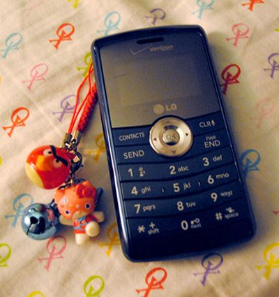 old cell phone with charms