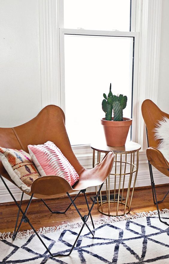 This gold table does double duty! Side table & plant stand in one.