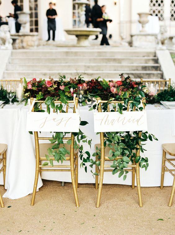 "Elegant ""just married"" wedding signs: http://www.stylemepretty.com/texas-weddings/austin/2016/08/20/elegant-winter-garden-wedding/ Photography: Ashley Bosnick - http://www.ashleybosnick.com/"