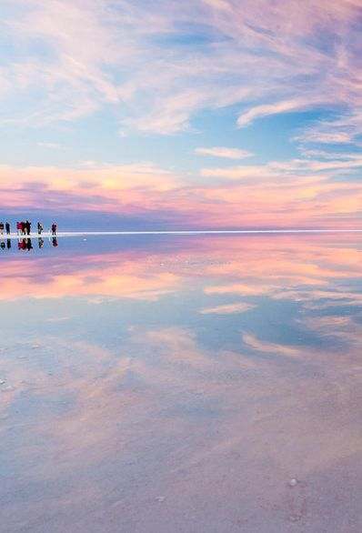 """Salar de Uyuni, Bolivia. These 4,086 square miles in southwest Bolivia make up the world's largest salt flat. The vast and incredibly flat plains and clear skies of Salar de Uyuni make it both one of the most famous """"natural mirrors"""" on the planet, as well as an ideal altimeter calibration site for Earth observation satellites. Read more about everything South America has to offer on theculturetrip.com"""