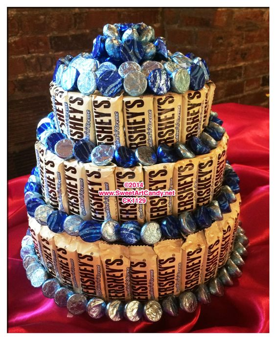 A 3 tier chocolate candy bar cake. Created with Hershey's Cookies and Cream bars ad surrounded by Hershey's Kisses. This is sure to make a delightful centerpiece or even substitute for a cake. Email S