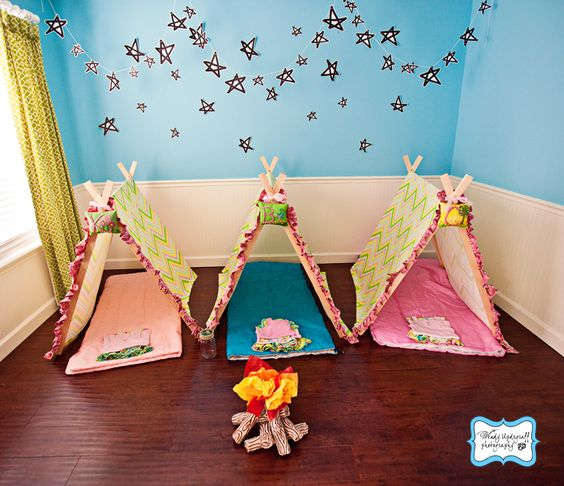 """Beautiful camp themed sleepover party. The mom made tents out of beautiful fabrics for each of the girls. Love the """"fire"""" as well!"""