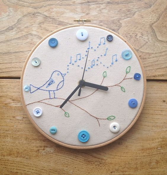 Embroidery hoop clock with button and hand by