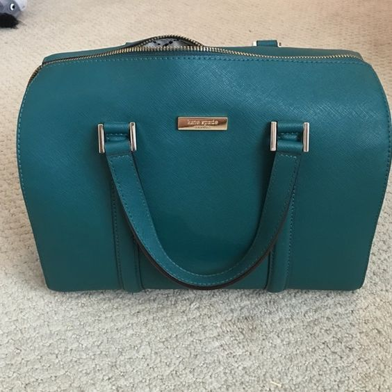 Kate Spade purse Beautiful teal Kate Spade purse. In good condition. Has a tiny spot on the inside of the zipper pocket inside. See attached picture please. It does not have the cross body strap. Comes with dust bag. kate spade Bags Mini Bags