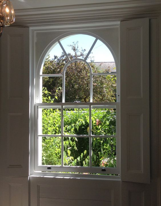 A Beautifully Crafted Double Glazed Arched Sash In Windsor