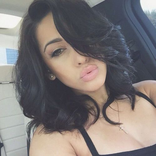 Jet-Black Hairstyle with Sultry Curls