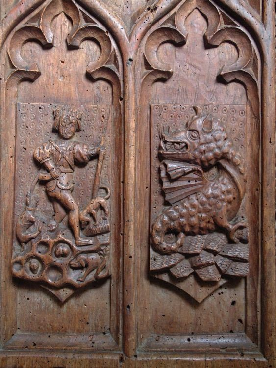 Tudor carved wooden dragon bench end, Launcells, Cornwall