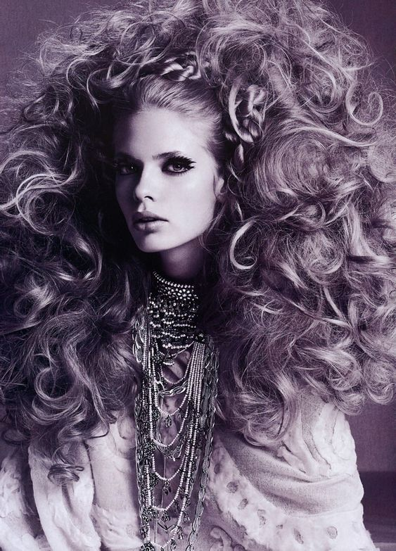 Photographed by Richard Burbridge. That is some big hair.