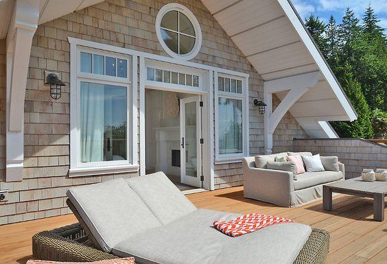 Shingle exterior the cedar shakes are treated to look for Cedar shake home designs