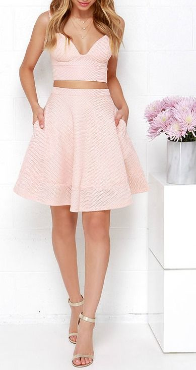 """Pink Two-Piece Dress! A sleeveless, tailored, bustier top with lightly padded cups is constructed by athletic-inspired, woven honeycomb fabric. Matching skirt has a fitted waist that flares into a full skirt. Dual exposed silver back zippers. Fully lined. Small top measures 14.5"""" long. Small bottom measures 20"""" long. 100% Polyester."""