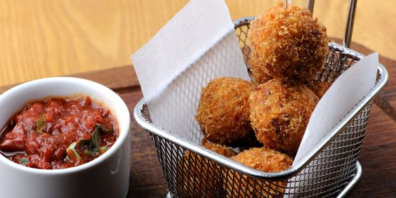 Arancini, or risotto balls, come served with a spicy homemade arrabiata sauce in this Paul Ainsworth arancini recipe inspired by Italian cuisine