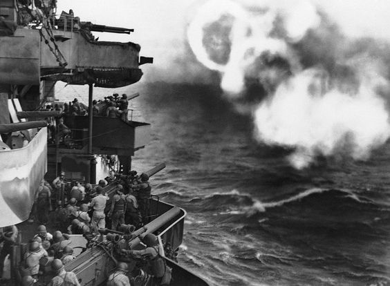 Secondary batteries of an American cruiser formed this pattern of smoke rings as guns from the warship blasted at the Japanese on Makin Island in the Gilberts before U.S. forces invaded the atoll on November 20, 1943.