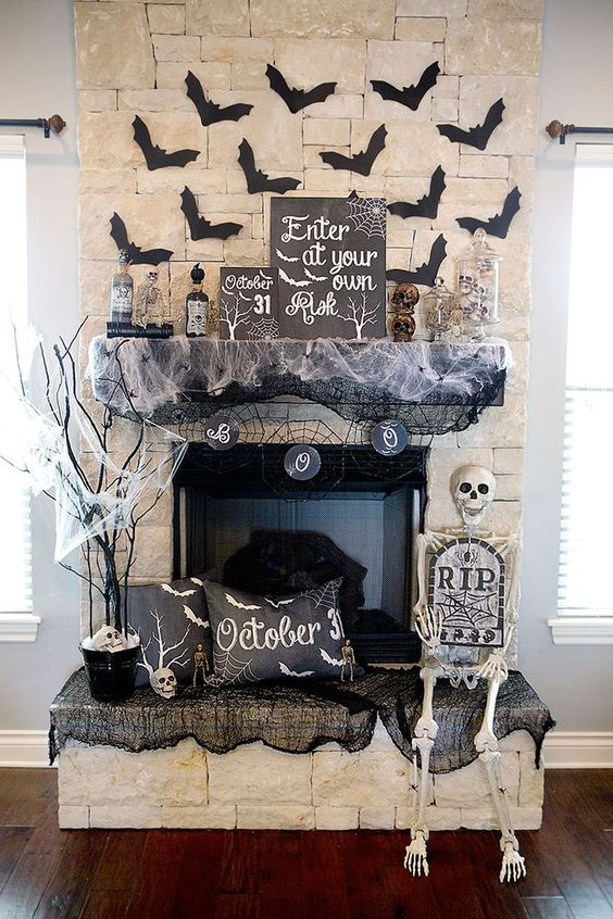 Halloween Mantel Decor with bats, webs and skeletons.