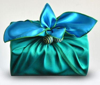 Gift Wrap--I wouldn't want to unwrap this beauty! Start looking for awesome clothes at the Thriftore that make neat rapping. Cheap and classy.