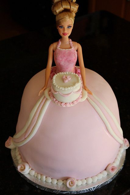 Elegant Barbie Cake  Had one like this as a kid.  They were so popular.  My mom made it and it had all these ruffles around it.  And she made sure to get the really blonde one like me.  Happy memory.