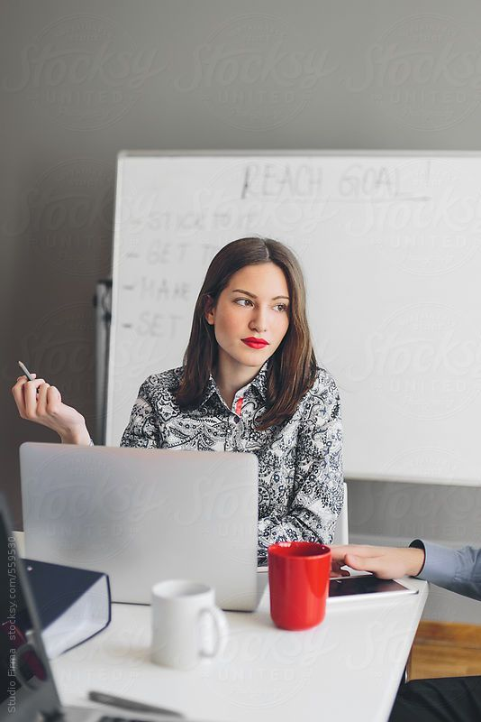 Businesswoman In A Meeting By Dijanato Stocksy United Edgy
