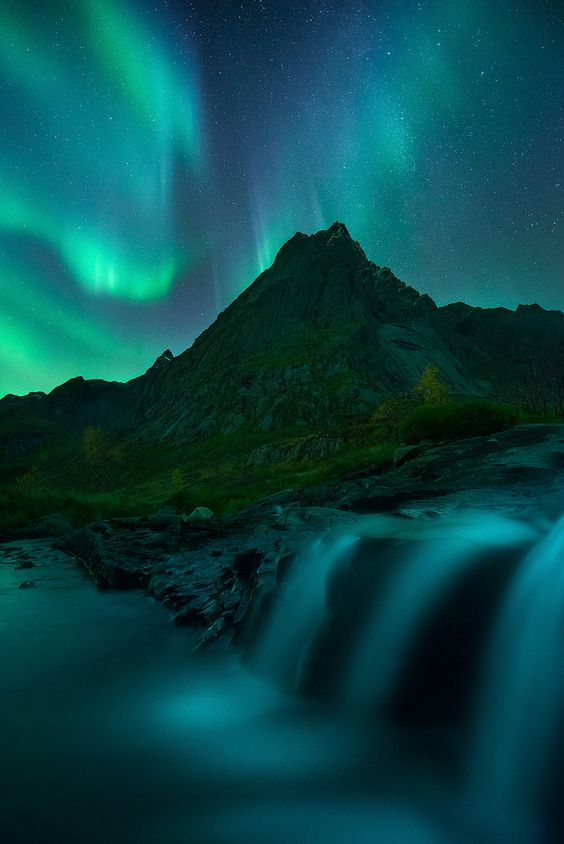 October Lights - A fantastic display of the Northern lights in the Lofoten Islands, by Arild Heitmann.. #arctic #aurora #auroraborealis #flakstad #light #lofoten #lofotentours #mountain #night #nordland #northernlights #norway #river #sky #stars #waterfall #winter