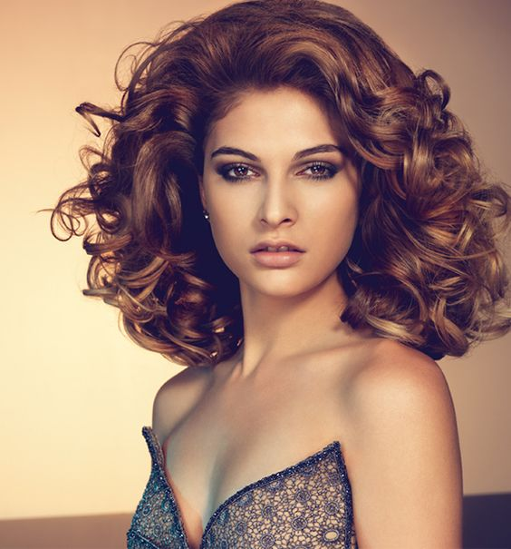 Big, brunette curls and volume, created by Great Lengths hair extensions