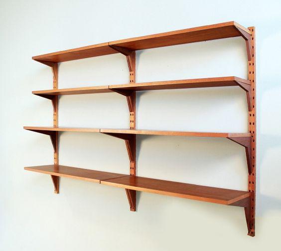 Estantería CADO en palisandro. Diseño de Poul Cadovius y N.H. Möller. Dinamarca, años 60.