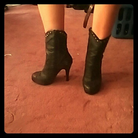 Black heel boots Only worn a couple of times, it has a neat skull design on the black part of the shoe as well. 5 inch heel, cheetah inside. Shoes Heeled Boots