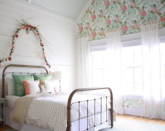 farmhouseforfour girls room, tarnished brass bed, peony wallpaper, shiplap, flower garland over bed, so pretty. Instagram