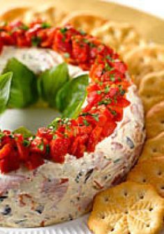 Antipasto Wreath -- Pepperoni and olives folded into two kinds of cheese: yum. Dress them up with roasted peppers and fresh basil and you have a festive appetizer that's holiday party-ready.: