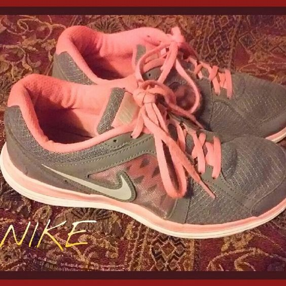 NIKE Dual Fusion Running Shoe Sz. 9 VGC! Pair of womens nikes flourescent orange and grey, orange is much more neon than pics show.  Lightly pre~owned condition.  In very good condition.  No modeling  Bundle discounts + save on ship! Nike Shoes Athletic Shoes