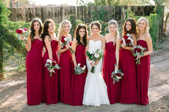 Love these red bridesmaid dresses... perfect for a winter wedding.... but id have boleros over the top