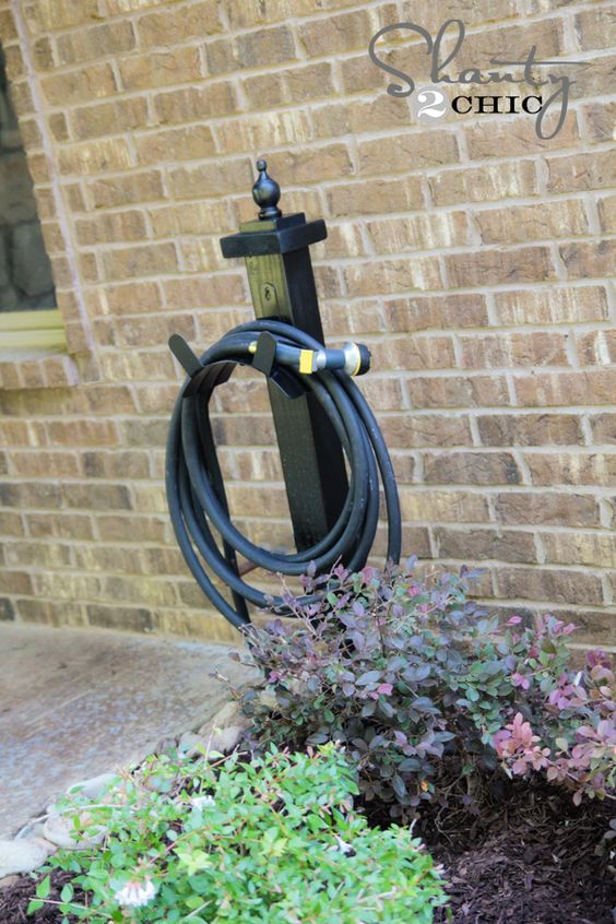 Create a unique hose holder for your garden. Follow along with this step-by-step guide to build your own. || @shanty2chic