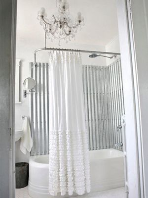 Sheets of corrugated metal (available at most Home Depot stores) make a stylish tub surround. After removing the plastic tub surround, cut the galvanized sheets to fit and finish the panels with Rust-Oleum Crystal Clear Enamel before screwing them in place. To prevent leaks, use self-sealing roofing screws and fill the seams with metallic caulk .