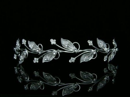 My Downton Abbey inspired bridal tiara/headband $11.99 plus shipping! Amazon.com: Vine Leaf Design Bridal Wedding Bridesmaid Prom Party Tiara Crown - Clear Crystals Silver Plating: Beauty
