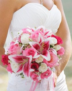A mix of pink-and-white Stargazer lilies and roses are punctuated with sparkly rhinestones.....I really like this but maybe not so much pink.