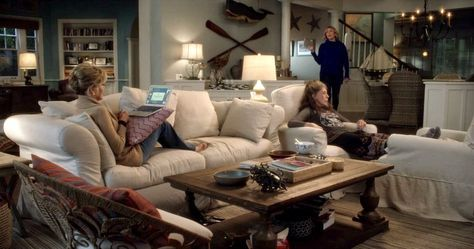Grace and Frankie beach house living room with white slipcovered furniture. #graceandfrankie