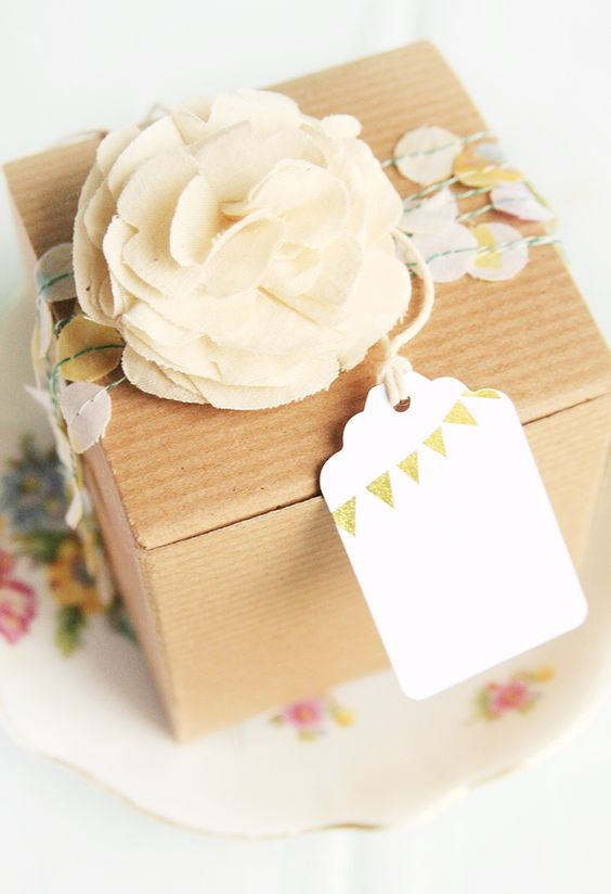 Loving the neutral tones of this gift packaging...would be cute to use the flower as a hair accessory