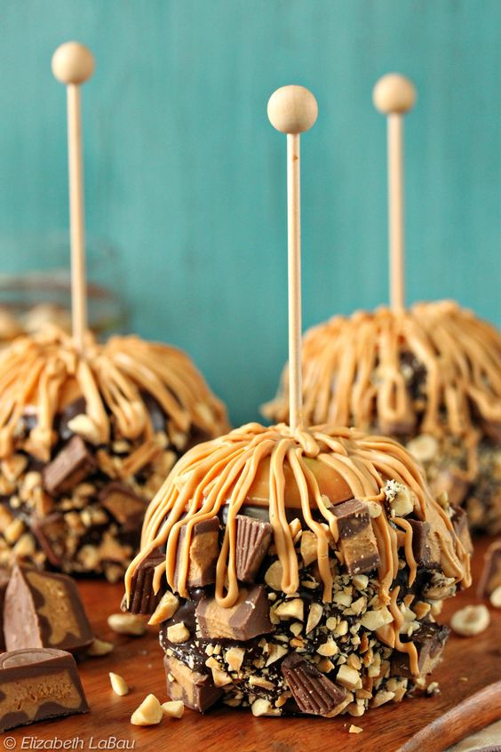 Peanut Butter Caramel Apples - with chocolate, peanuts, peanut butter cups, and a peanut drizzle! | From candy.about.com