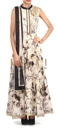 Buy Online from the link below. We ship worldwide (Free Shipping over US$100). Product SKU - 305488.Product Link - http://www.kalkifashion.com/cream-printed-anarkali-suit-adorn-in-embroidered-butti-only-on-kalki.html