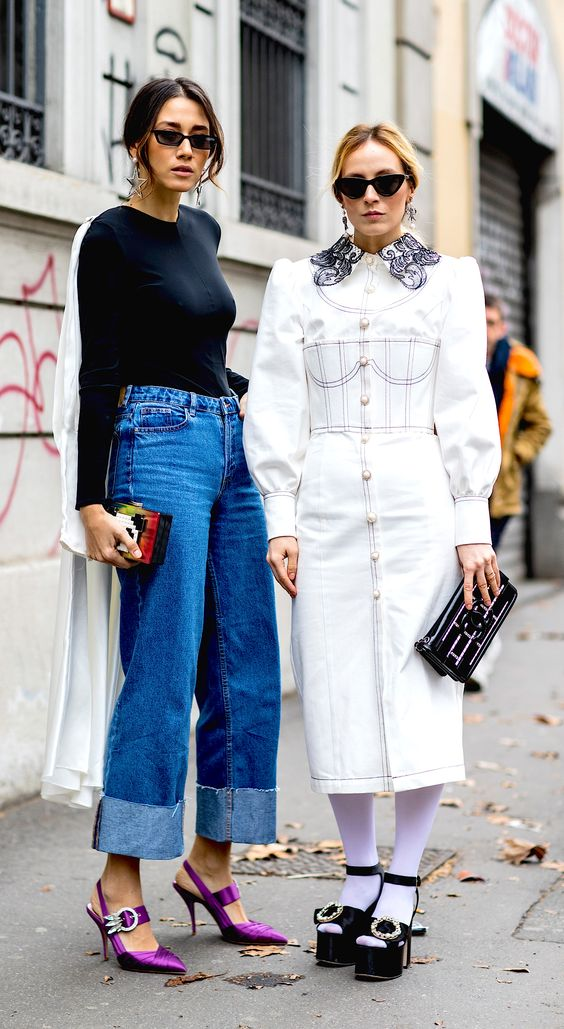 Two friends, two different styles. Milan Fashion Week, fall 2018