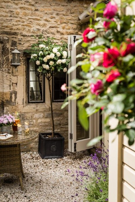 The rose covered courtyard at Little Scarlet, Burford