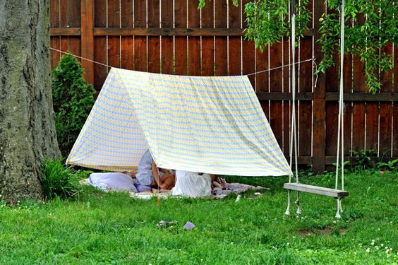 easy tent with a sheet, rope, and tent stakes