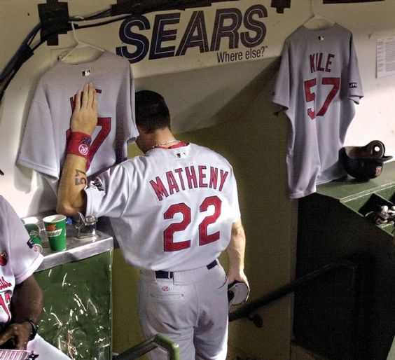 Mike Matheny touches jersey of his friend & teammate after a loss to the Cubs 6/23/2002