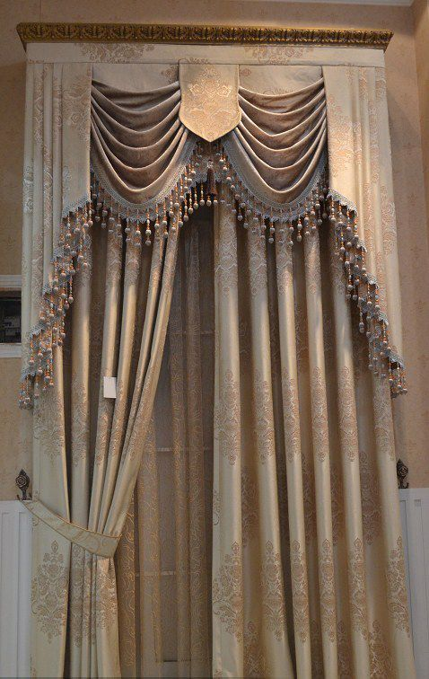 Formal swags and jabots mounted within an upholstered for Elegant window curtains