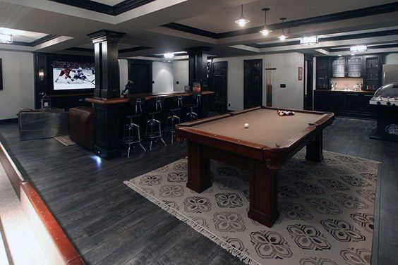 dark-hardwood-flooring-basement-design-with-pool-table-and-movie-room.jpg…